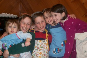 5 kids in aprons sewn by Savta